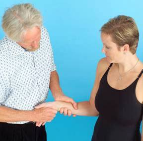 Once the proximal row has been successfully mobilized, using a slight force, distract the metacarpal phalangeal joints one at a time with client's hand in a neutral position.