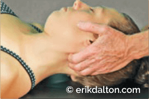 Image 6: Occipitalatlanto (O-A) correction: the client tucks the chin and therapist applies 2 seconds of mild overpressure to help align the O-A & level the craniocervical junction. Side-bend the head 20 degrees to the right, then to the left. Repeat. Clinically, it appears righting reflexes may trigger neck and pelvic muscle spasticity in an a