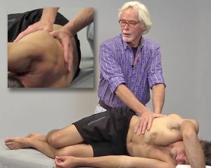 Image 6: Client grasps top of therapy table. Therapist's soft palms meet on the lateral ribcage and hook the fascia. Client pulls down on therapy table against therapist's resistance to a count of five, then relaxes. Therapist lifts the thorax to decompress the vertebral discs. Repeat.