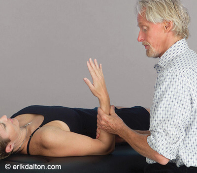 Image 3: With the elbow pinned to the client's side, the forearm is rotated to the first supination barrier. The client gently pronates the arm against resistance to a count of five and relaxes. I supinate to the next restrictive barrier and repeat until full supination is reached.