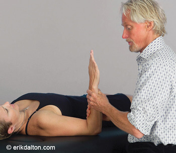 Image 4: The forearm is rotated to the first pronation barrier and the client gently supinates against resistance to a count of five and relaxes. I rotate to the next restrictive barrier and repeat until full pronation is achieved.
