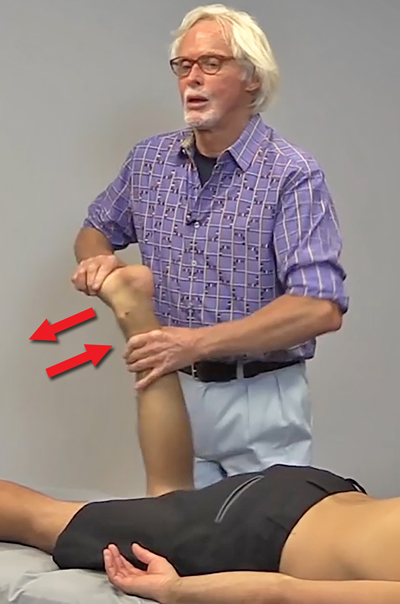Image 2: The therapist's right hand slings the client's ankle into eversion and the left hand resists. The goal is to reduce the peroneal muscle spasm and ligamentous ankle adhesions.