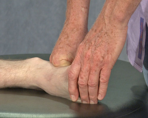 Erik Dalton demonstrating a technique using his fist on bottom of the foot.