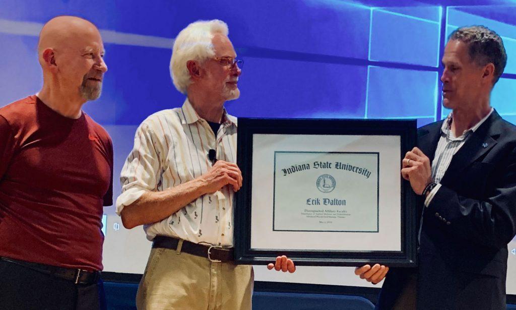 "Charlie Peebles and Dr. John Pommier present Erik Dalton with the ISU ""Distinguished Affiliate Faculty Member"" award"