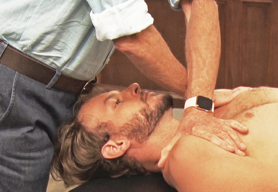 Figure 8. Crossed-armed shoulder depression technique for bilateral PMRF weakness