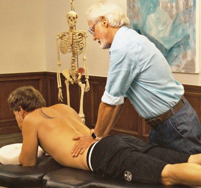 Image 3. Sphinx Hyperextension Test: The client assumes a pain-free sphinx position and the therapist's soft palms apply very gentle pressure to each side of the lumbar spine. Record as positive for possible Z-joint pathology if the client reports localized low-back or gluteal pain.